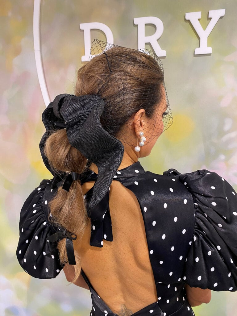 A picture of the stylist's hair do at Cup Day.